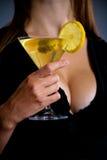 Beautiful young lady holding martini Stock Image