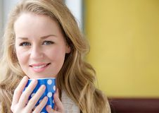 Beautiful young lady holding tea cup at home Royalty Free Stock Photo