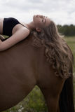 Beautiful young lady with horse Royalty Free Stock Images