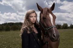 Beautiful young lady with horse Stock Image