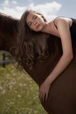 Beautiful young lady with horse Royalty Free Stock Photos