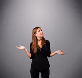 Beautiful young lady juggling with copy space Stock Images