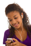 Beautiful young lady listening to music Stock Photos