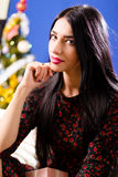 Beautiful young lady with long hair sitting calm Royalty Free Stock Photo