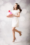 Beautiful young lady looking at heart box on bokeh background Stock Photo