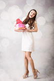 Beautiful young lady looking at heart box on bokeh background Stock Photography