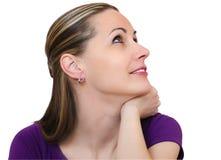 Beautiful young lady  looks upwards Stock Image