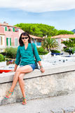 Beautiful young lady in mediterranean harbour Royalty Free Stock Photos
