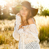 Beautiful young lady model in field - outdoors shot Stock Photography