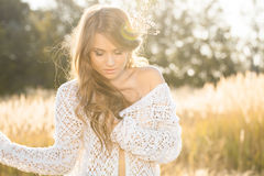 Beautiful young lady model in field at sunrise Royalty Free Stock Image