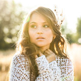 Beautiful young lady model in field at sunrise - outdoors shot Royalty Free Stock Photography