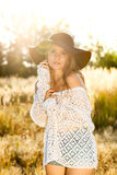 Beautiful young lady model in field - sunrise shot Royalty Free Stock Photos