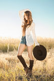 Beautiful young lady model posing in field Stock Image