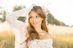 Beautiful young lady model posing in a field at sunrise - close up shot Royalty Free Stock Photography