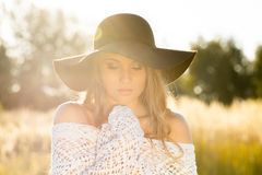 Beautiful young lady model posing in a field at sunrise - outdoors shoot Stock Photography