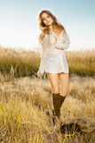 Beautiful young lady model wandering through field Stock Photo