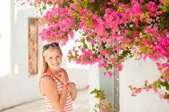 Beautiful young lady near flowers Stock Photos