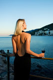 Beautiful young lady near the ocean Stock Images