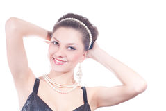 Beautiful young lady with pearls jewelry isolated Royalty Free Stock Photos