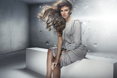 Beautiful young lady with perfect dense hairstyle Stock Images