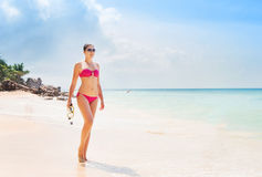 Beautiful, young lady in pink swimwear posing on the beach with a diving mask Stock Images