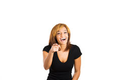 Beautiful young lady pointing at you and laughing aloud Stock Photography