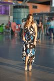 Beautiful young lady. Posing at the airport dressed in a long dress royalty free stock photos