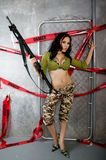Beautiful Young Lady Posing in Camouflage Stock Photography