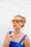Beautiful young lady in protect glasses with Royalty Free Stock Images
