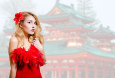 Beautiful young lady in red dress on japanese Royalty Free Stock Images