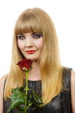 Beautiful young lady with red rose. Stock Photo