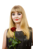 Beautiful young lady with red rose. Stock Photography