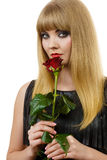 Beautiful young lady with red rose. Royalty Free Stock Image