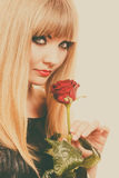 Beautiful young lady with red rose. Royalty Free Stock Images