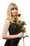 Beautiful young lady with red rose. Royalty Free Stock Photo