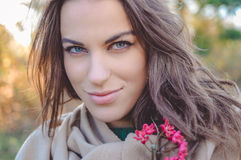 Beautiful young lady in shawl smiling and holding Royalty Free Stock Photography