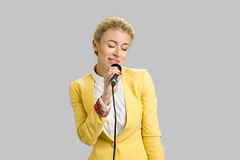 Beautiful young lady singing karaoke. Stock Photo