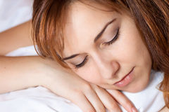 Beautiful young lady sleeps on the bed. Royalty Free Stock Images