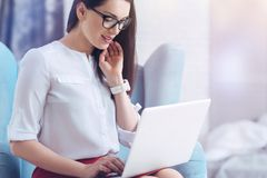 Beautiful young lady smiling while working at her office royalty free stock images