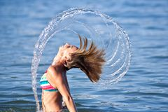 Beautiful Young Lady Splashing With Her Hair Royalty Free Stock Photography