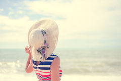 Beautiful young lady in straw hat resting on sunny Royalty Free Stock Image