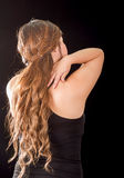 Beautiful young lady Suffer crick after workout in a black background Royalty Free Stock Images