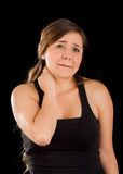 Beautiful young lady Suffer crick after workout in a black background Royalty Free Stock Photos