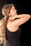 Beautiful young lady Suffer crick after workout in a black background Stock Photos