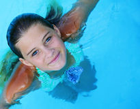 Beautiful young lady swimming