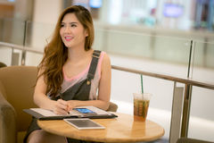 The Beautiful young lady with tablet sitting at the summer terra Stock Photos