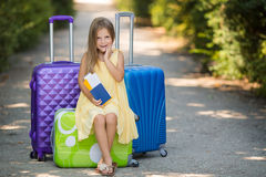 Beautiful young lady travelling with a suitcase Royalty Free Stock Image