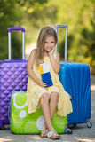 Beautiful young lady travelling with a suitcase Royalty Free Stock Images