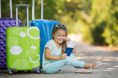Beautiful young lady travelling with a suitcase Royalty Free Stock Photo
