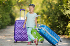 Beautiful young lady travelling with a suitcase Royalty Free Stock Photography
